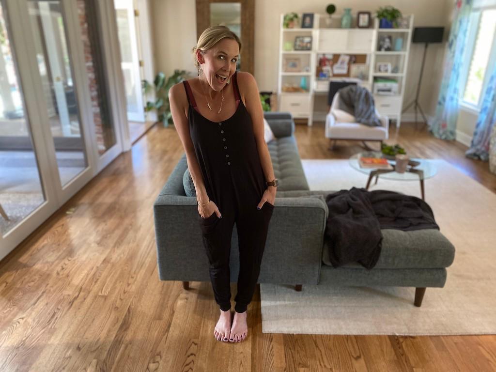 woman wearing black jumpsuit in living room