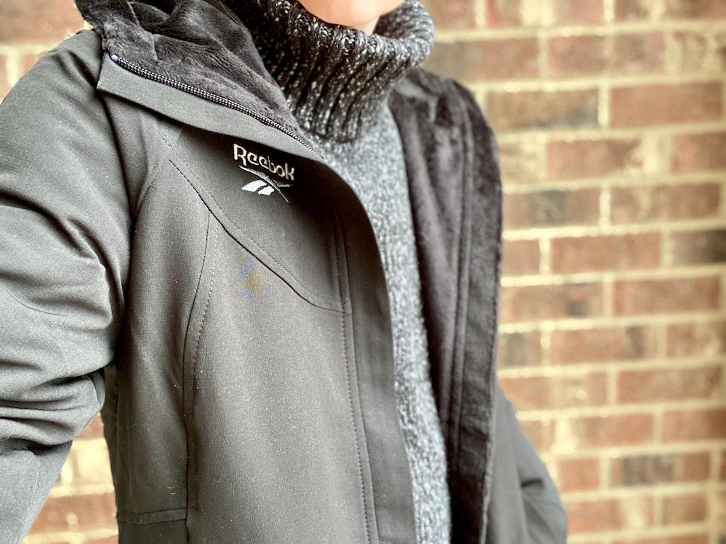 woman wearing reebok jacket with grey sweater