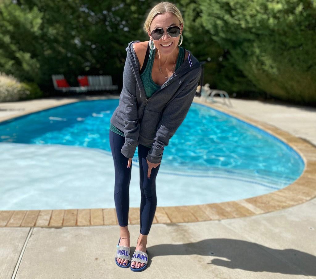 woman wearing walmart slides