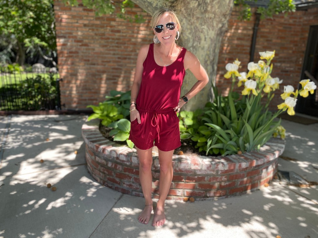 woman wearing red jumpsuit shorts