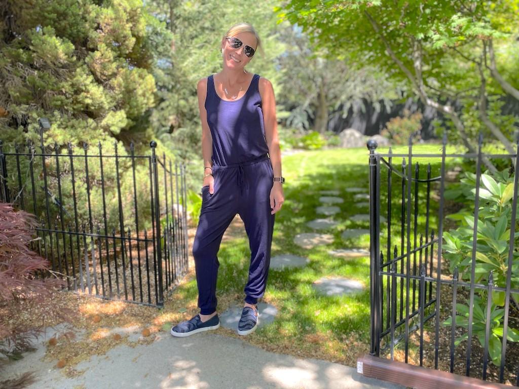 woman wearing blue jumpsuit