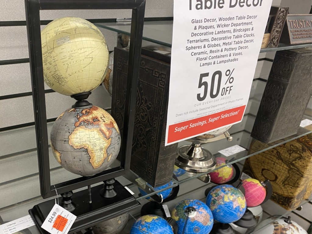decorative stand with two globes on store shelf