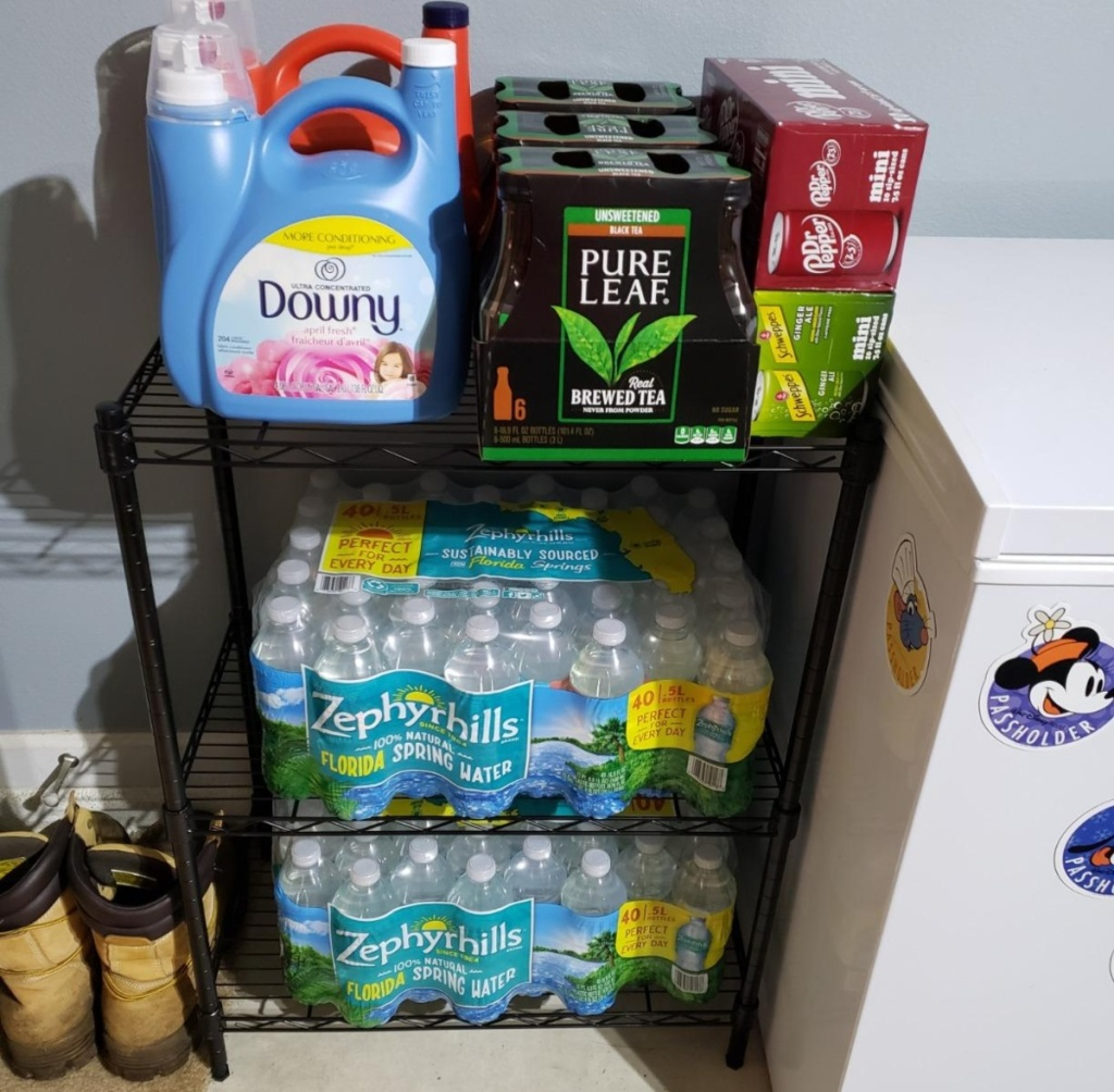 laundry supplies and bottled water on shelves