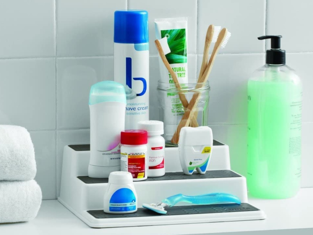 3-tier shelf organizer filled with bath and beauty products