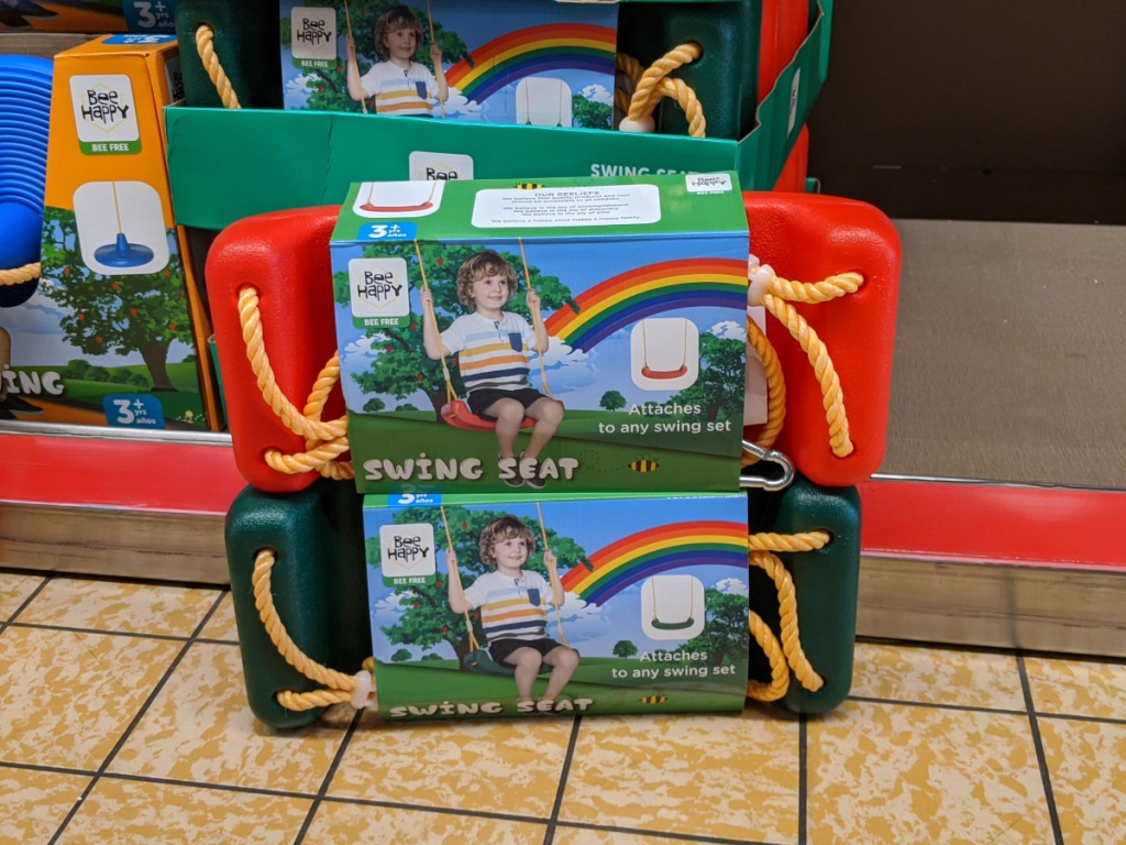 two bee happy swings seats stacked on each other at aldi