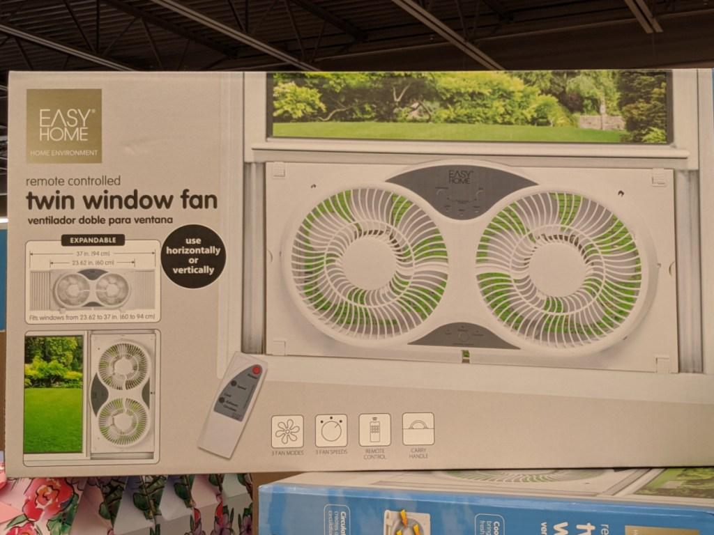 twin window fan in a box sitting on a store shelf