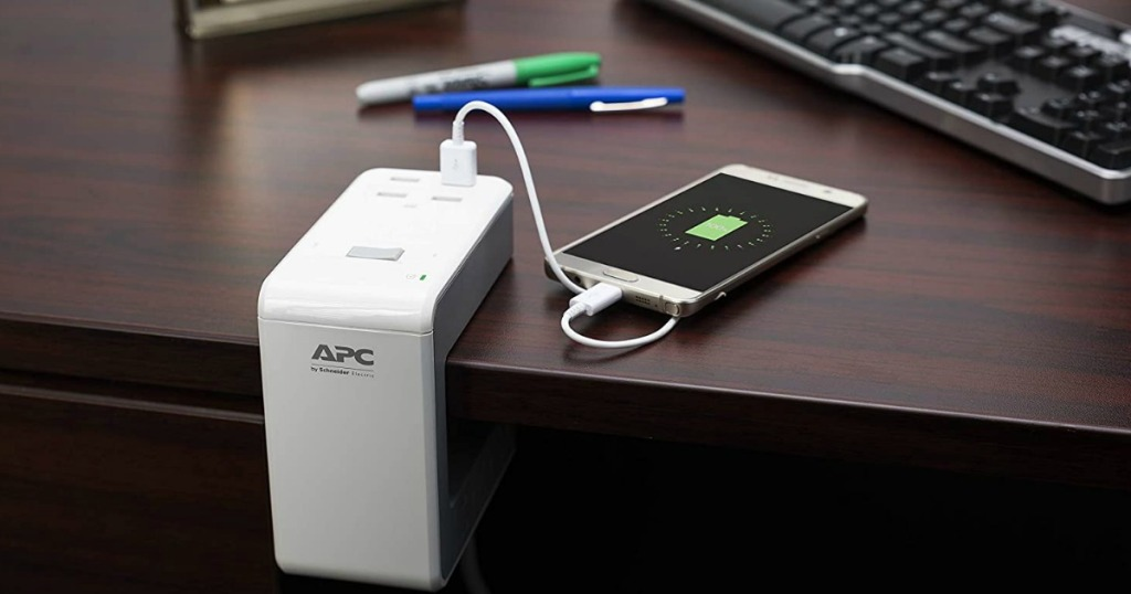 apc charger on a desk connected to a phone