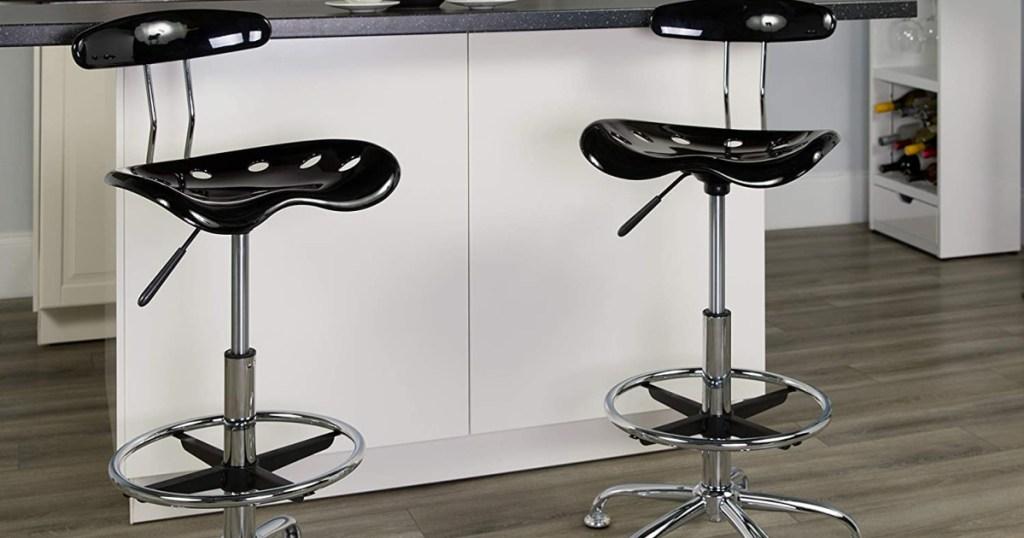 black draft stools at counter
