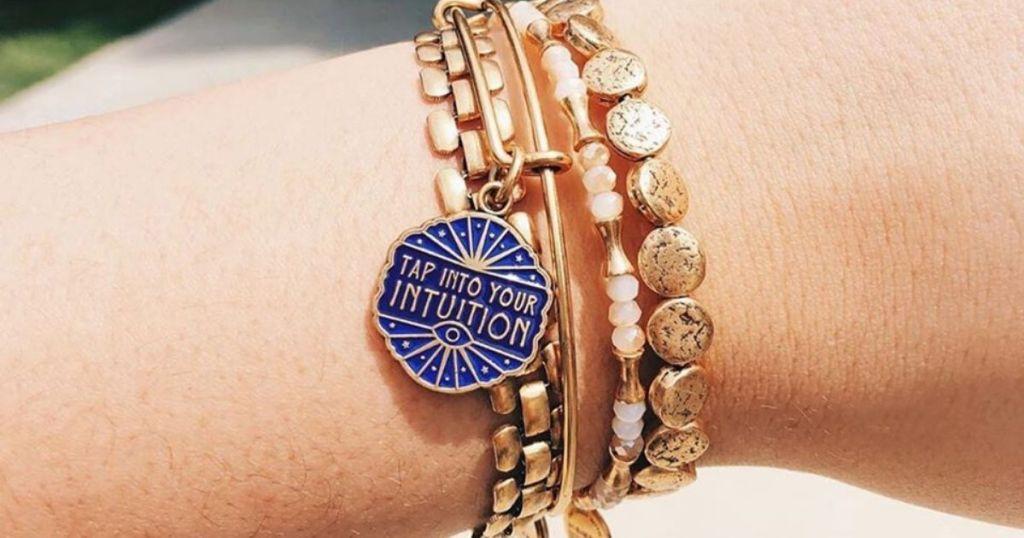 woman's wrist wearing bracelets
