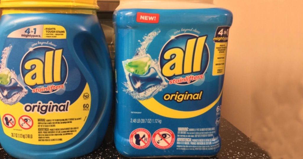 2 giant tubs of all laundry detergent sitting next to each other on a counter