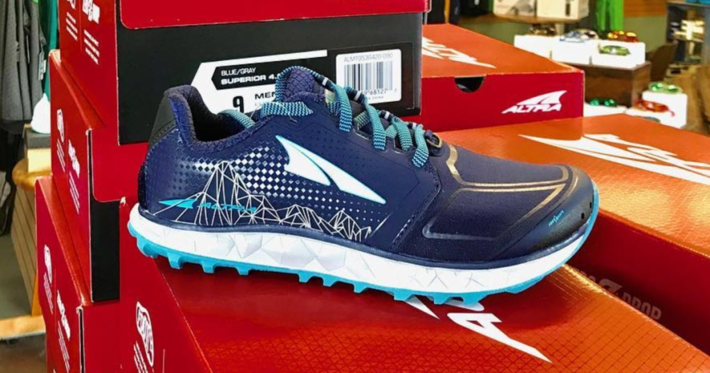 blue Altra Superior 4 Trail Running Shoes on top of box
