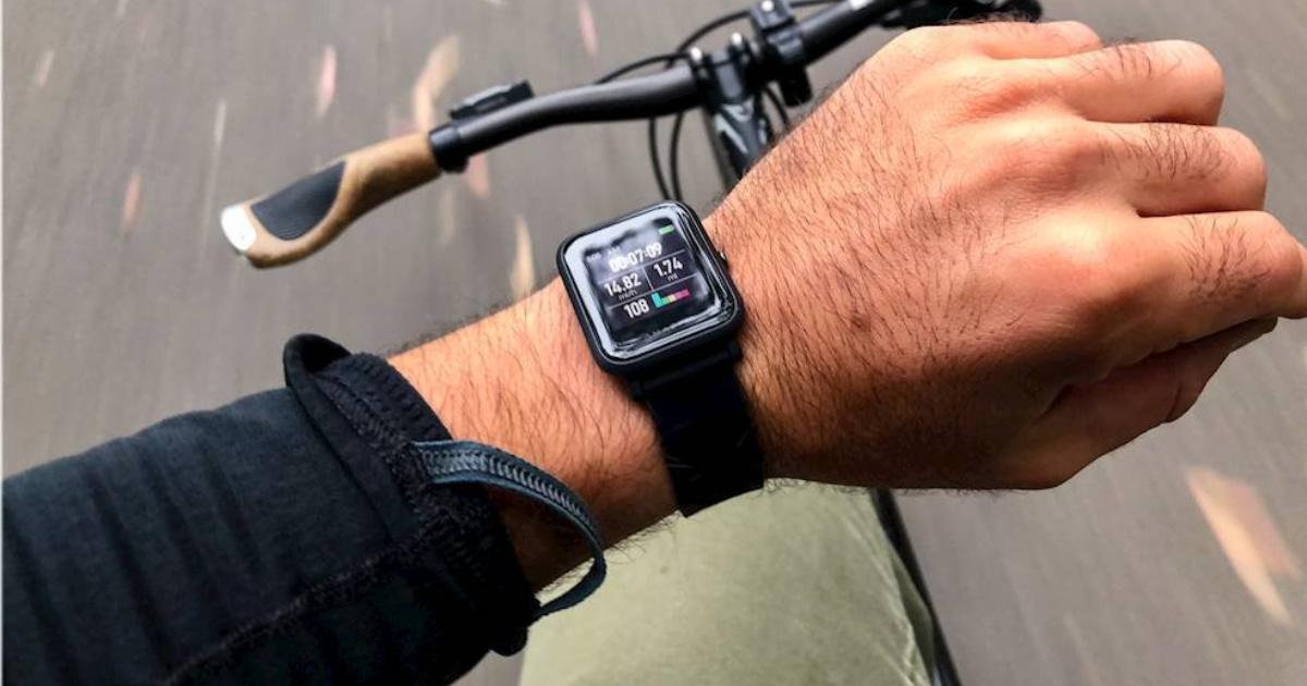 man riding bike and wearing smartwatch