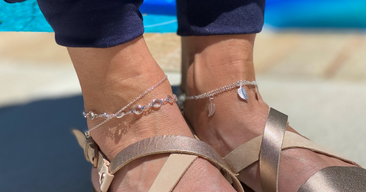 person wearing sandals and anklets