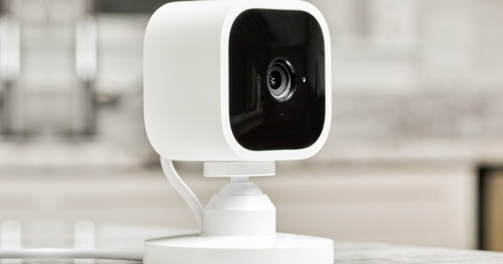 white security camera on counter in home