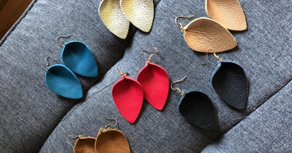 different color Genuine Leather Teardrop Earrings sitting on a couch