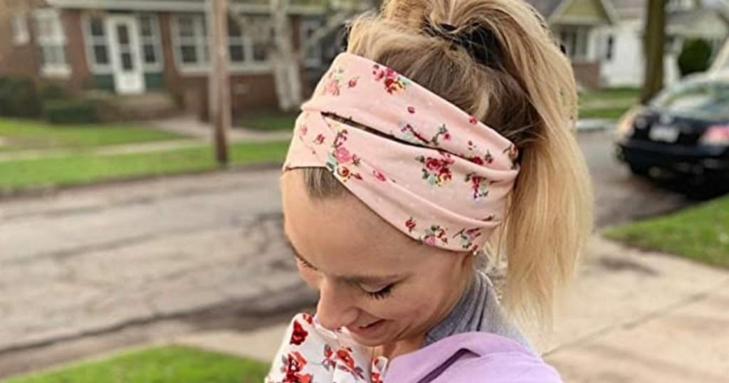 Woman wearing pink floral headband