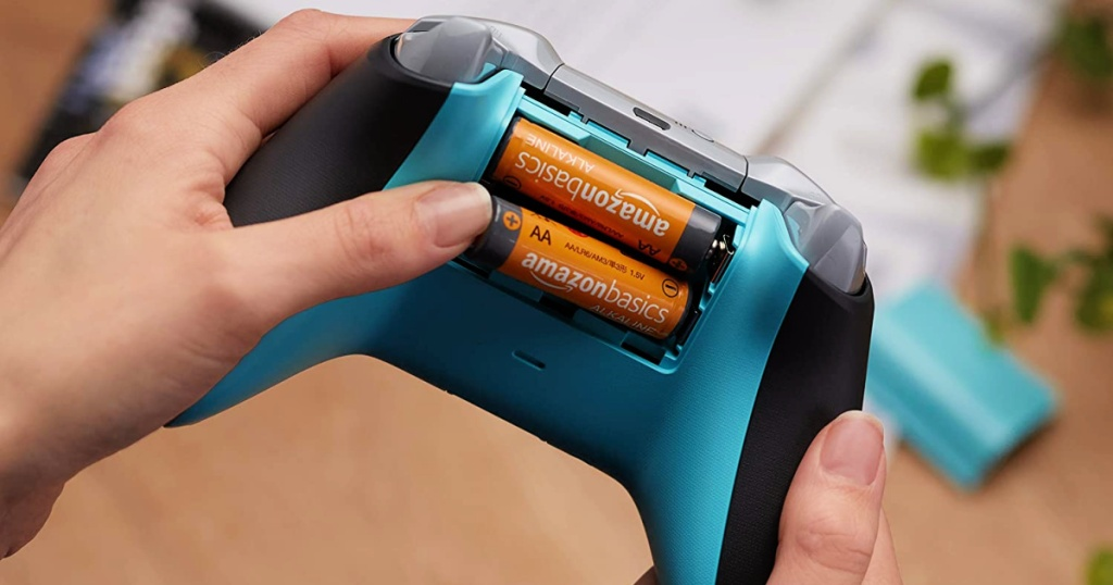 AmazonBasics AA Rechargeable Batteries being put in game controller