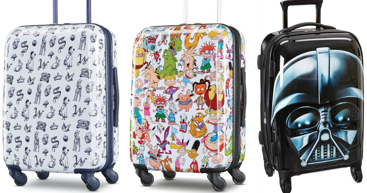 stock images of three suitcases with character prints