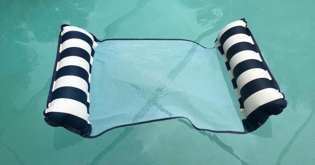 Aqua 4-in-1 Monterey Hammock Supreme Float in navy color floating in pool