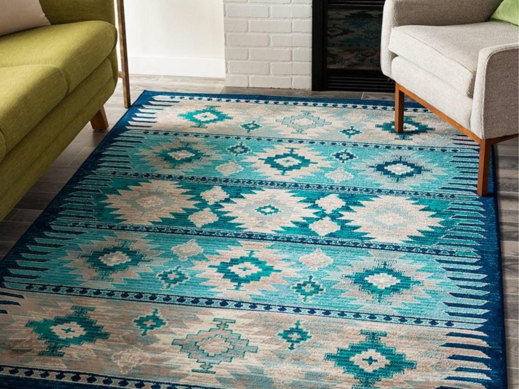aqua and grey geometric bohemian rug on wood floor in living room