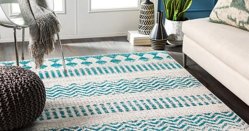 blue & white area rug in living room