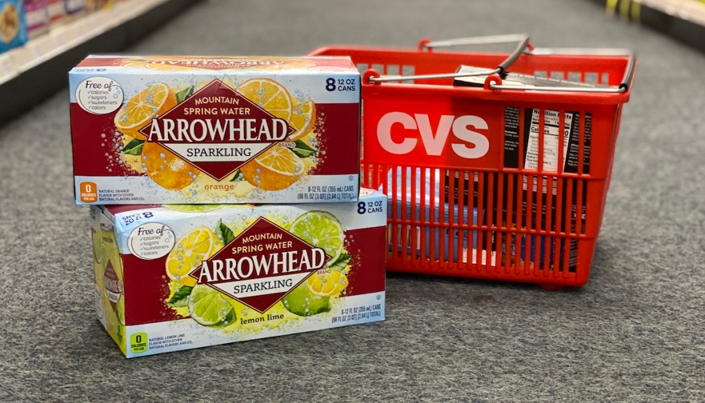 two cases of Arrowhead sparkling water next to CVS basket