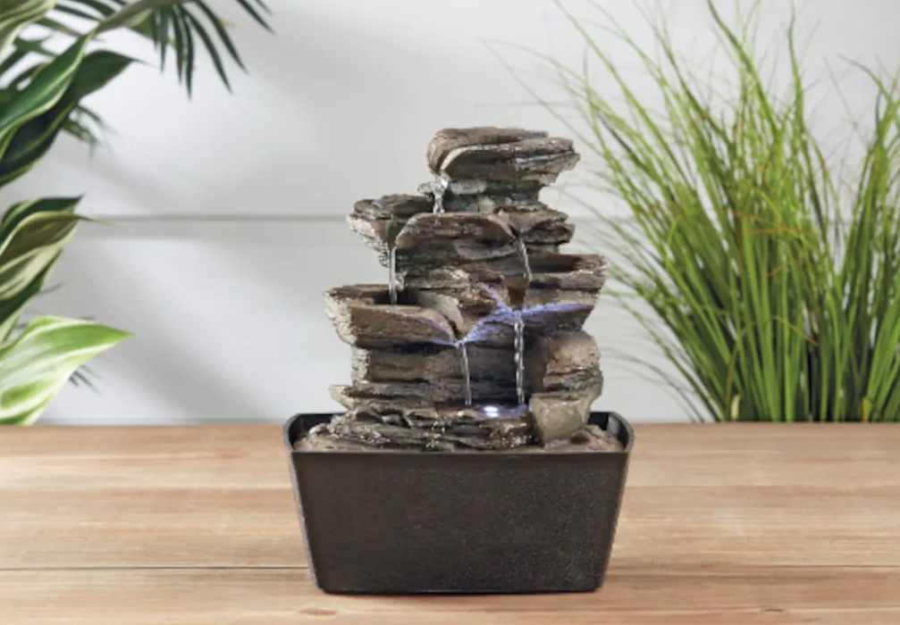 small stone water fountain on a table