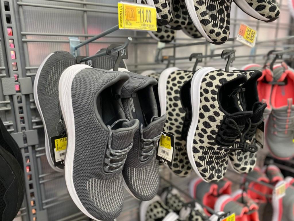 women's gray sneakers hanging in store