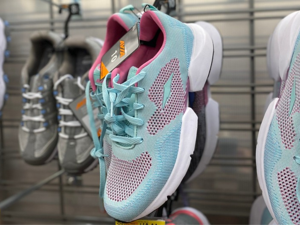 light blue and pink sneakers hanging in store