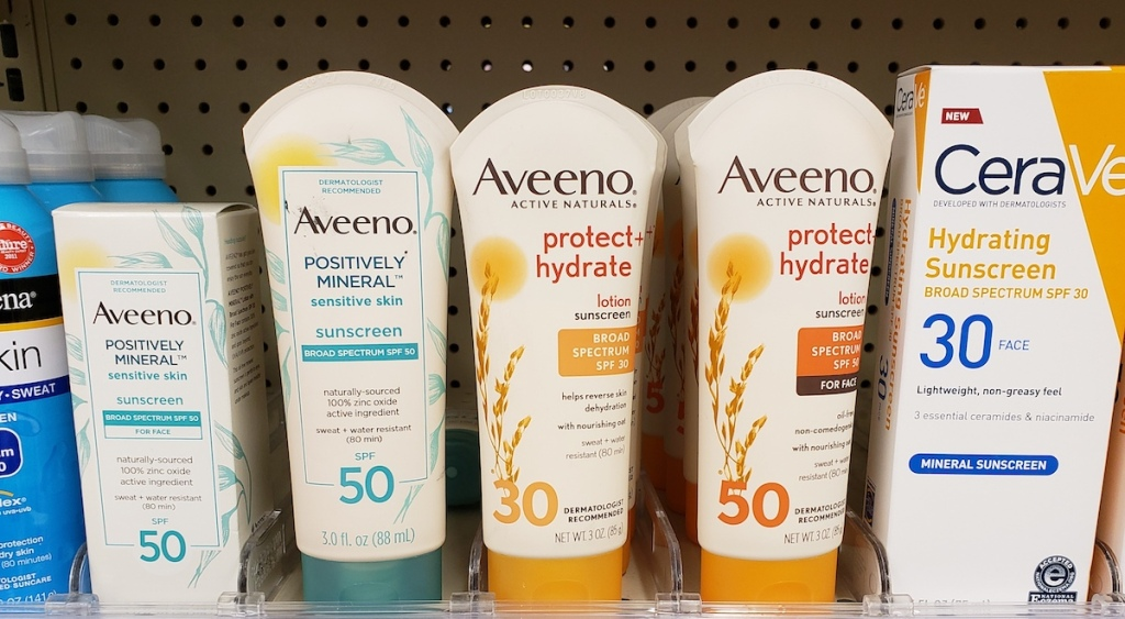 row of Aveeno sunscreen on a shelf