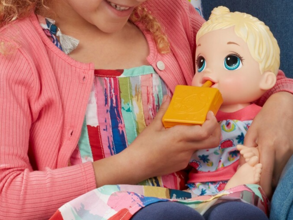 girl playing with blonde doll