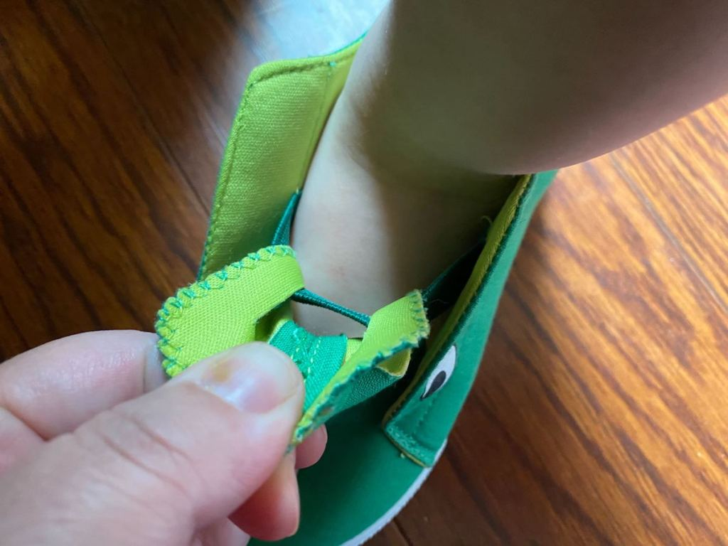 Baby alligator shoes on toddler