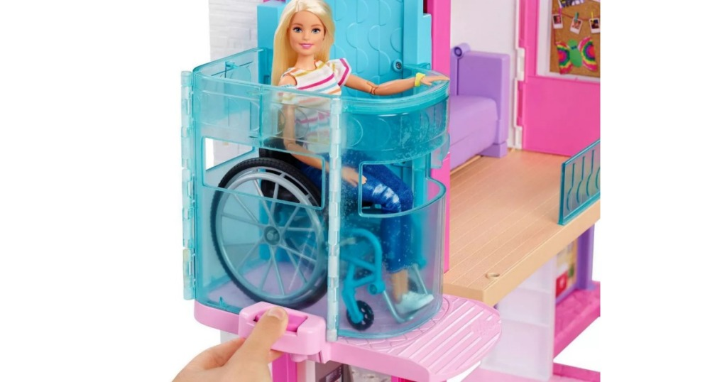 Barbie in wheelchair riding on elevator