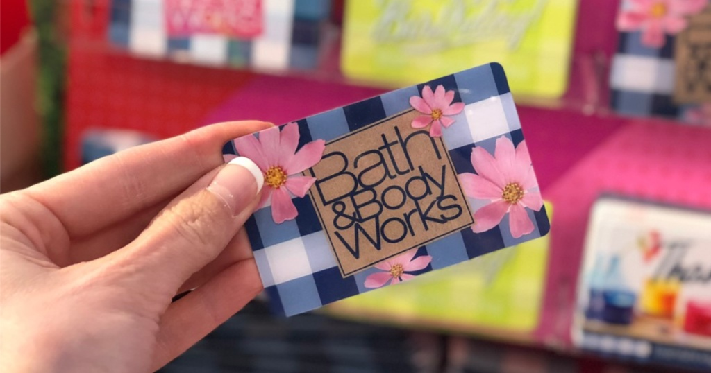 hand holding a Bath & Body works gift card