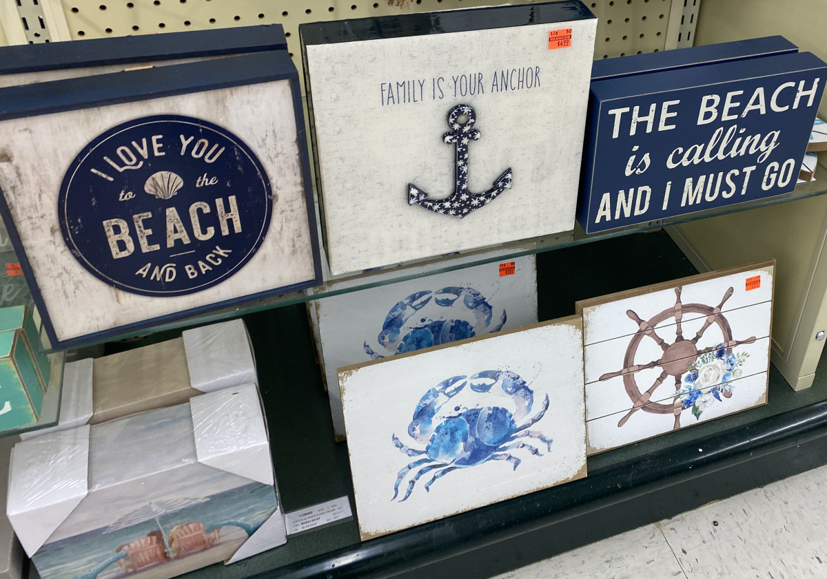 """""""Family Is Your Anchor"""" wall decor on store shelf with other beach-themed decor"""