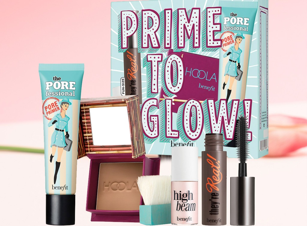 benefit primer, highlighters and mascara set on a pink background