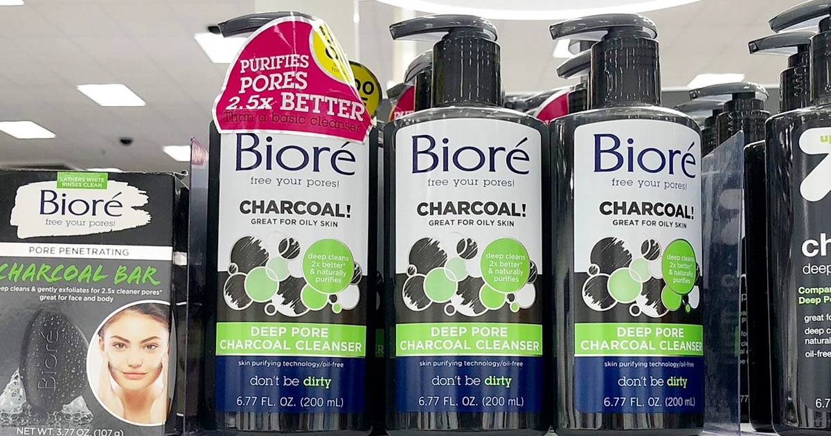 three black bottles of biore charcoal face wash on store shelf