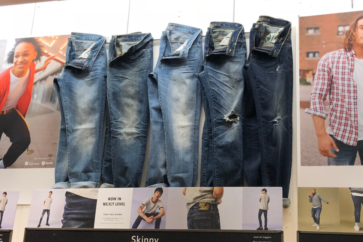 american eagle jeans men hanging on wall