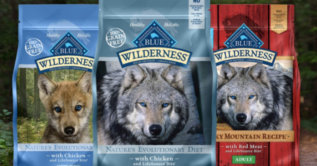 three bags of dog food with outdoor background