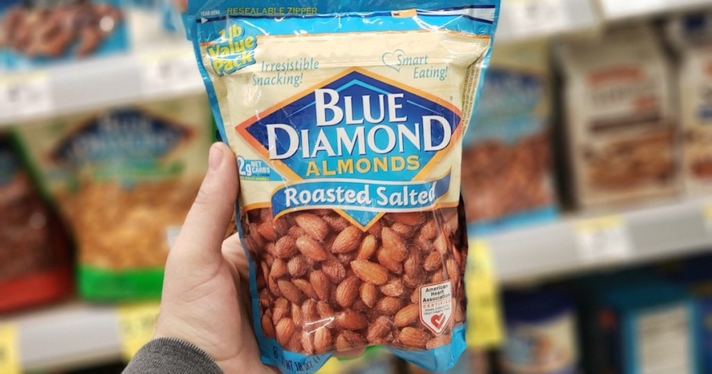 man hand holding blue bag of Blue Diamond Almonds Roasted Salted