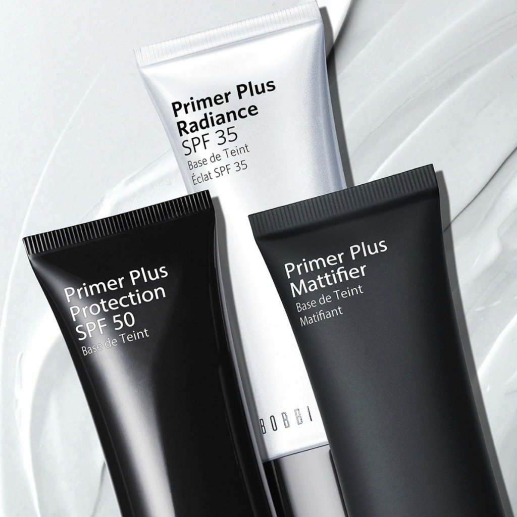 Three tubes of high end primer in black and white