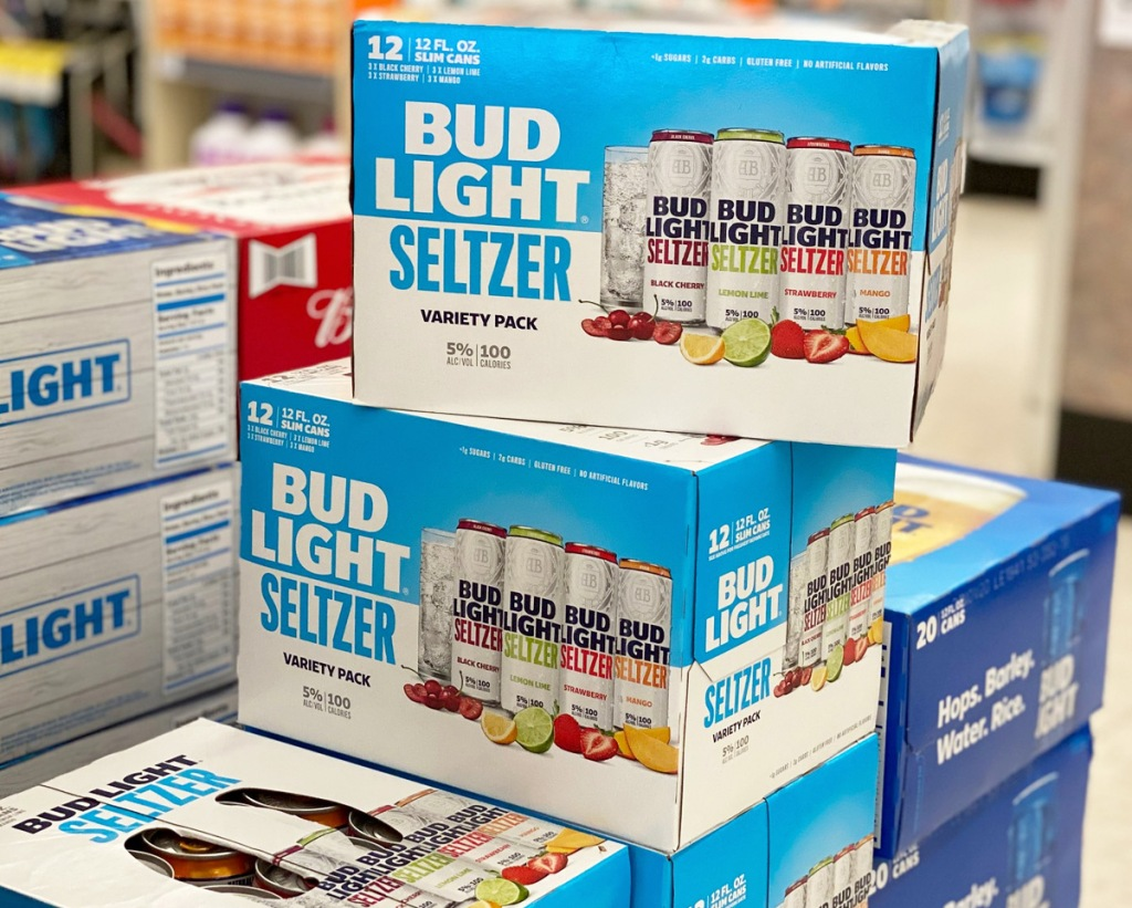 blue and white boxes of bud light seltzer stacked on each other