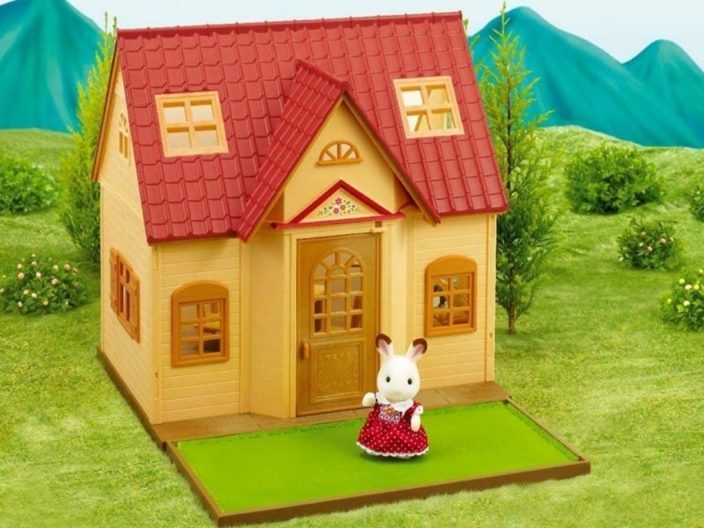 Calico Critters cottage on grass scene with rabbit figure