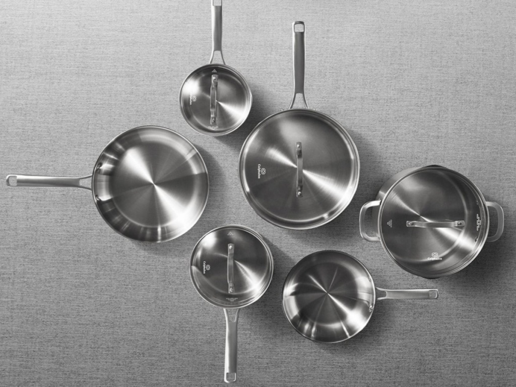 stainless steel cookware set on gray surface