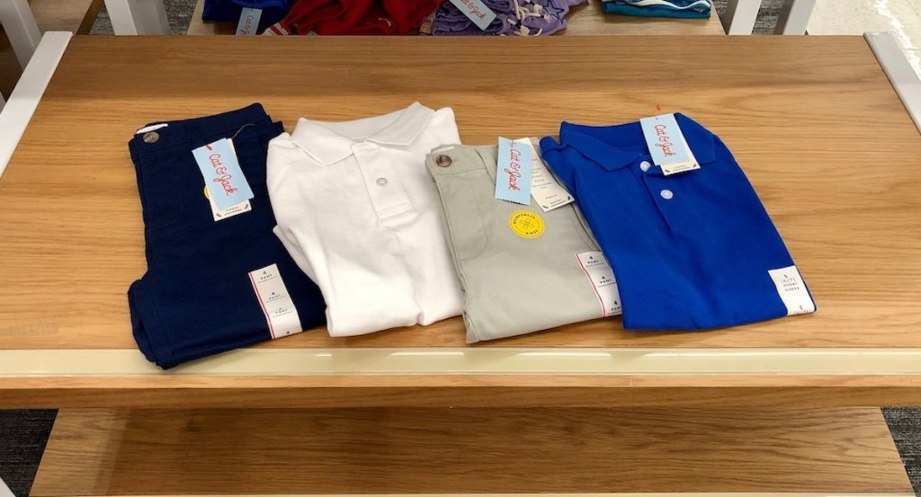 Cat & Jack uniform polo shirts and pants on table