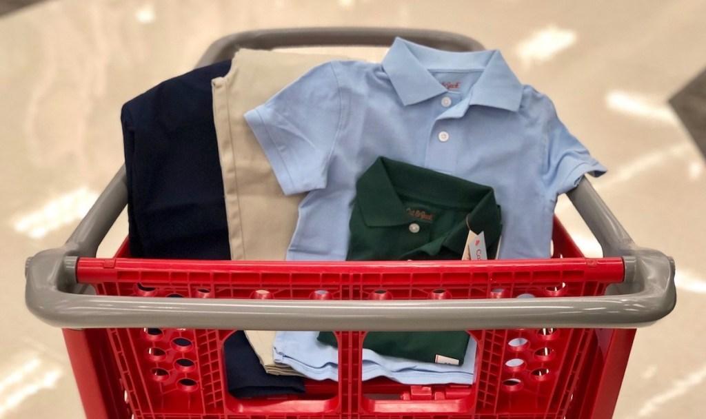 light blue and dark green cat and jack uniform polo and khaki and dark blue uniform pants in target cart