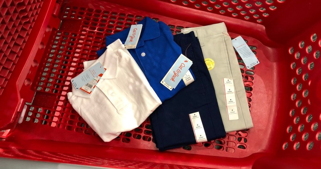 cat and jack uniform pants and polos in the bottom of a target cart