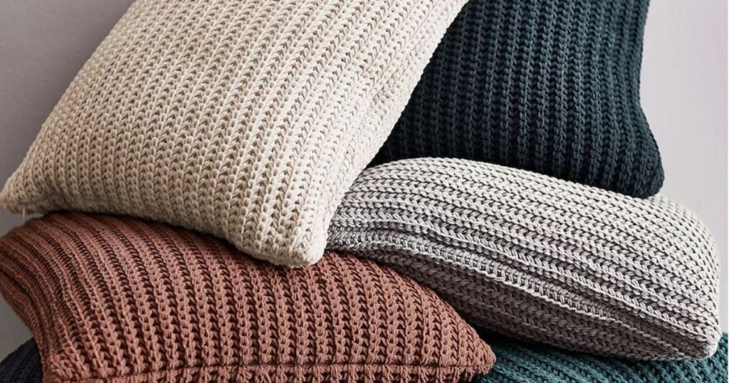 Pile of chenille throw pillows
