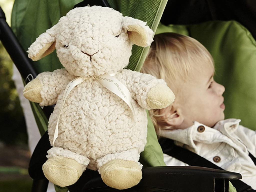 child's sleeper sheep animal on stroller with child awake inside