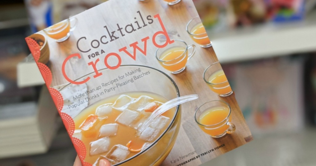 hand holding a Cocktails for a Crowd Cookbook